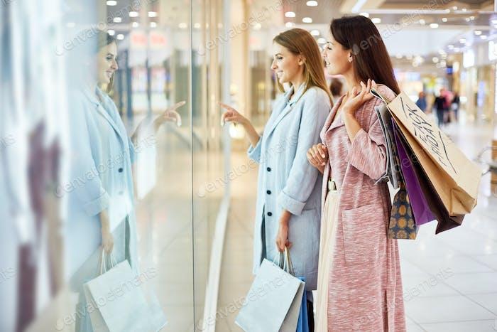 Two Young Women Window Shopping in Mall