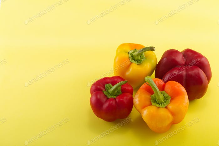 Sweet bellpepper on a colored background. Studio light. Top view