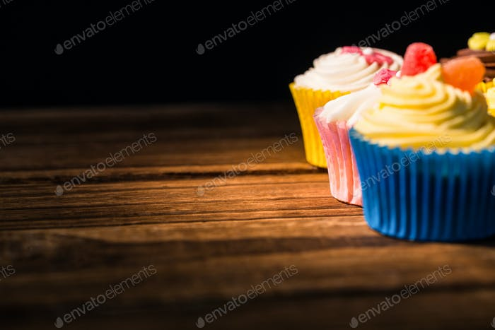 Delicious cupcakes on a table shot in studio