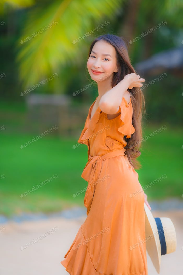 Portrait beautiful young asian woman happy smile relax on the be