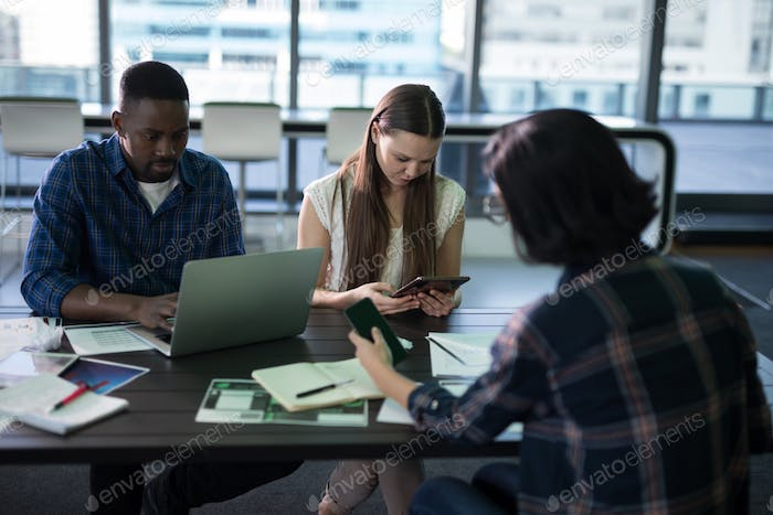 Executives working together in office
