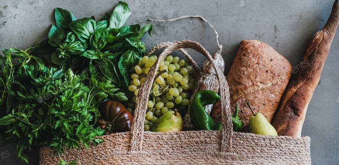 Flat-lay of healthy shopping bag with fresh produce, wide composition