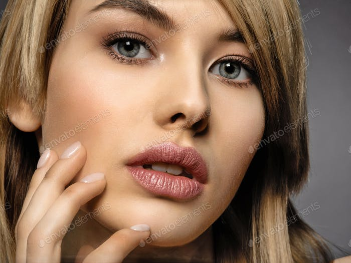 Woman with beauty face and clean skin.  Sexy blonde woman.