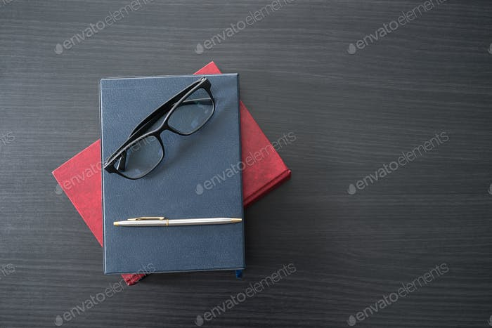 Glasses and book on the wood desk-4