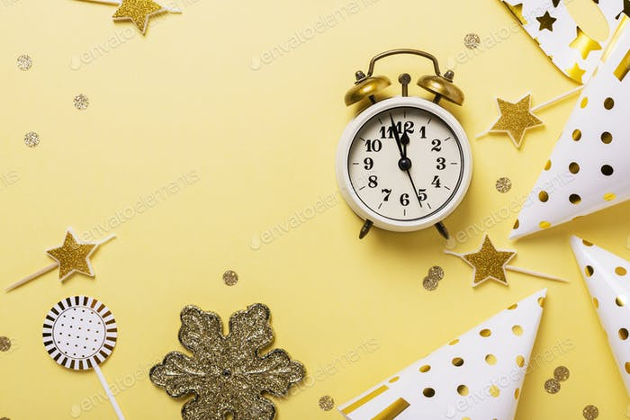 Christmas card with party hats, masks and clock