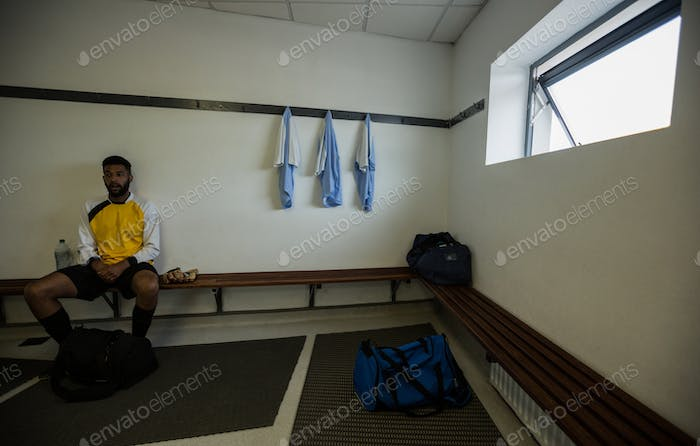 Player relaxing in changing room