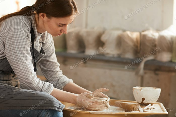 Creating ceramic pot in workshop