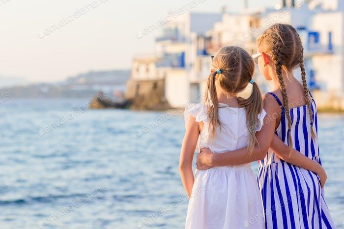Adorable little girl at Little Venice the most popular tourist area on Mykonos island, Greece