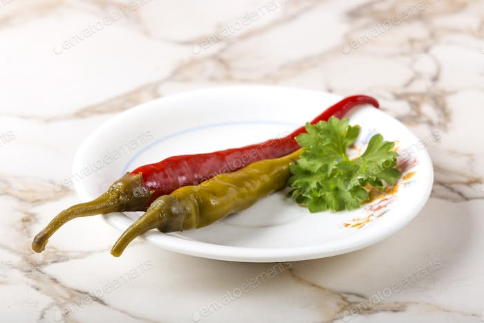 Pickled green and red peppers