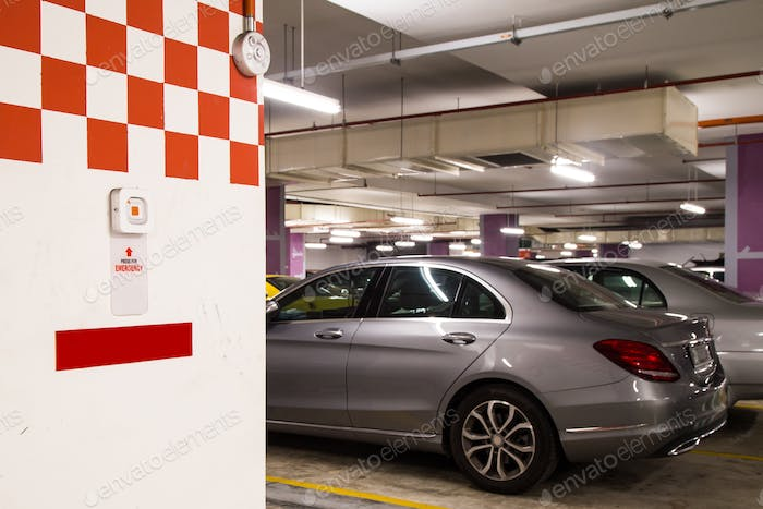 Emergency alarm panic button at car park complex for security