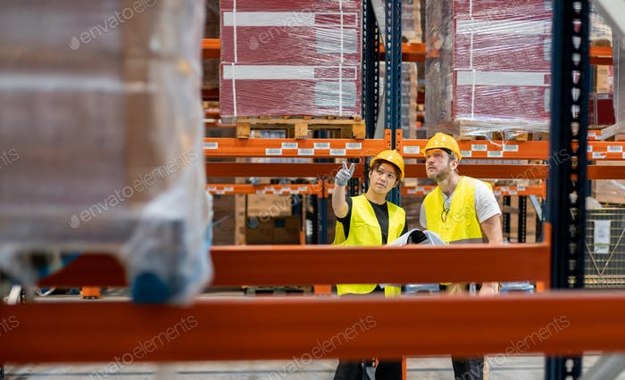 Warehouse workers establish order of packages on shelves