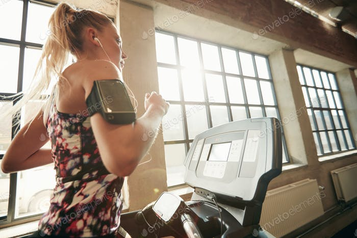 Female working out on a treadmill at gym