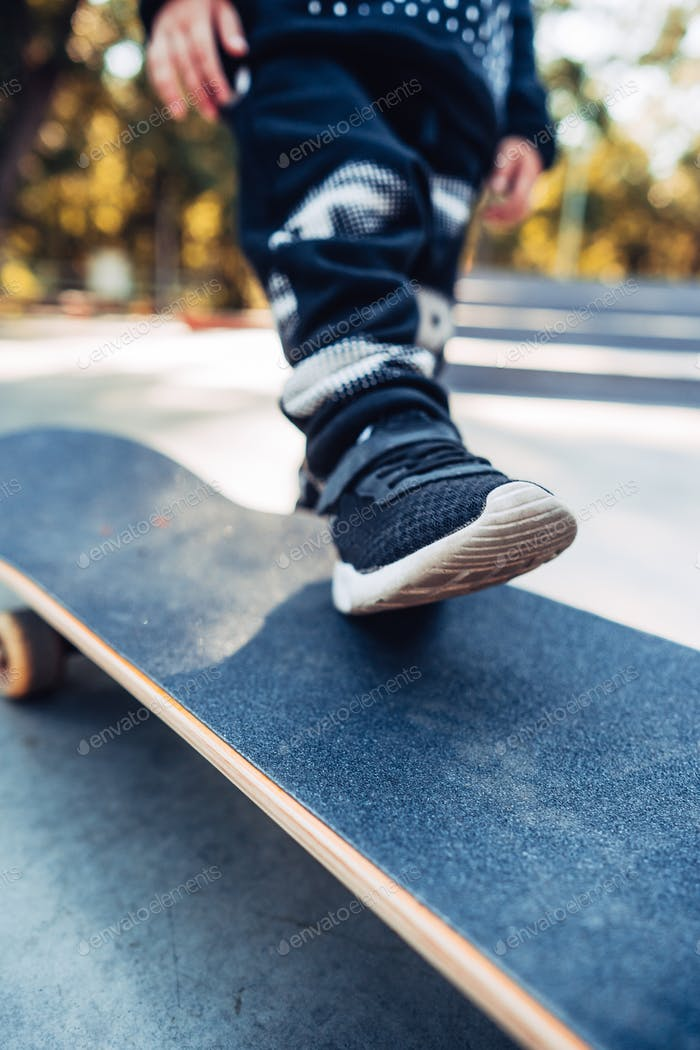 Boy legs on the skateboard close up image