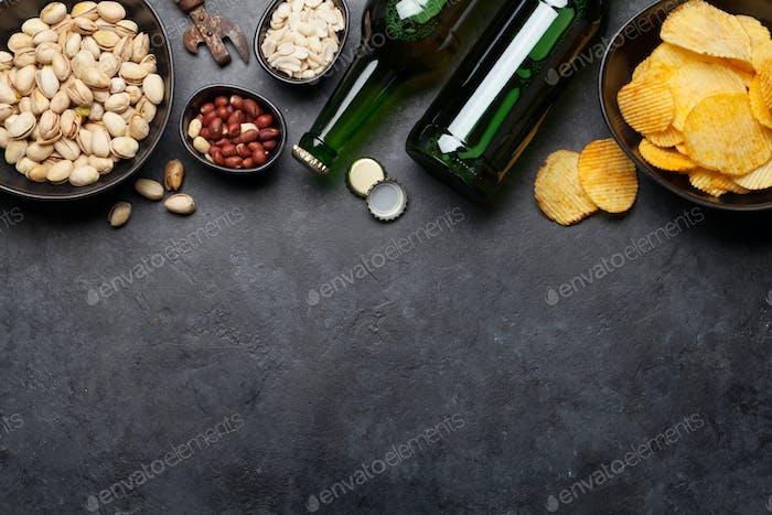 Bottled beer and snacks