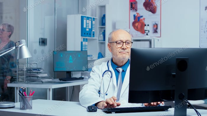Doctor working in busy clinic