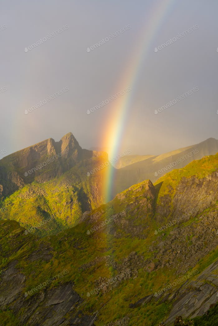 Rainbow in the mountains on Senja Island, Troms County