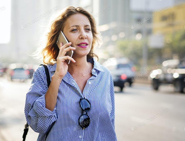 Caucasian woman with a smartphone