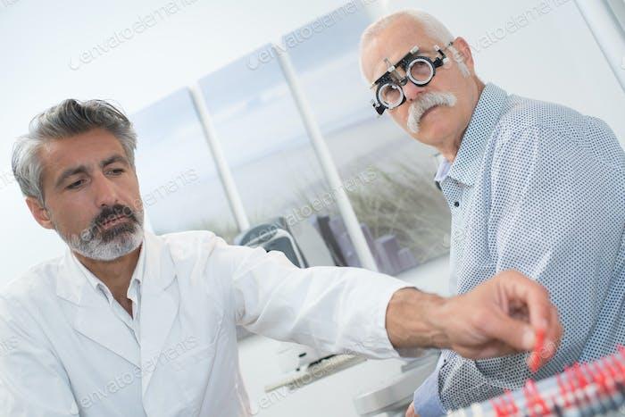Senior man having his eyes tested