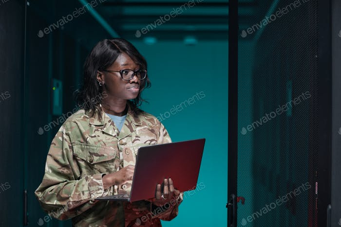 Female IT Technician Inspecting Sever