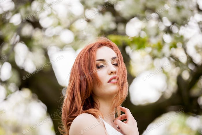 Gorgeous redhead woman in outdoor photo