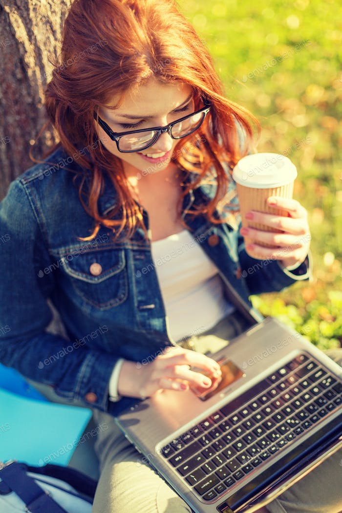 teenager in eyeglasses with laptop and coffee