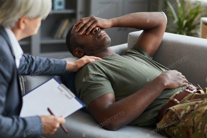 Depressed soldier at psychologist