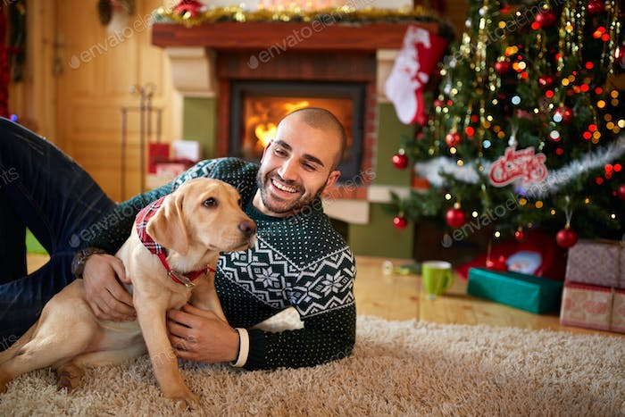 Man with his dog on Christmas eve