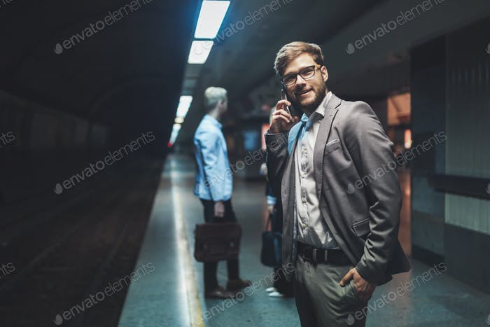 Business people waiting for subway transportation