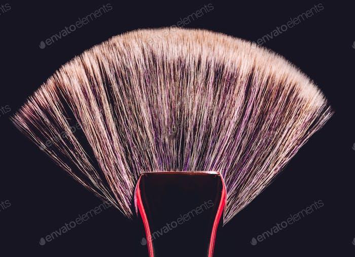 Conturing makeup brush on black background