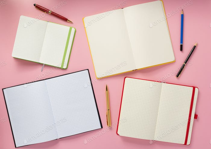 notebook and pen at abstract background