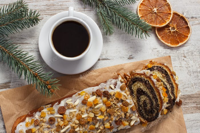 Poppy seeds cake, cup of coffee and spruce branches, christmas time