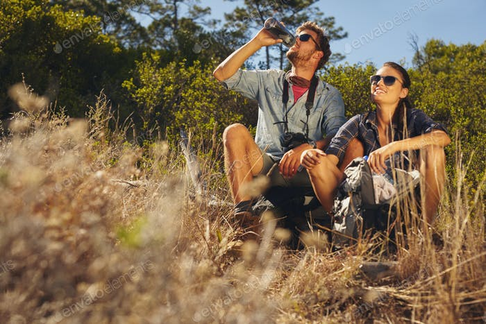 Young couple taking a break on hike