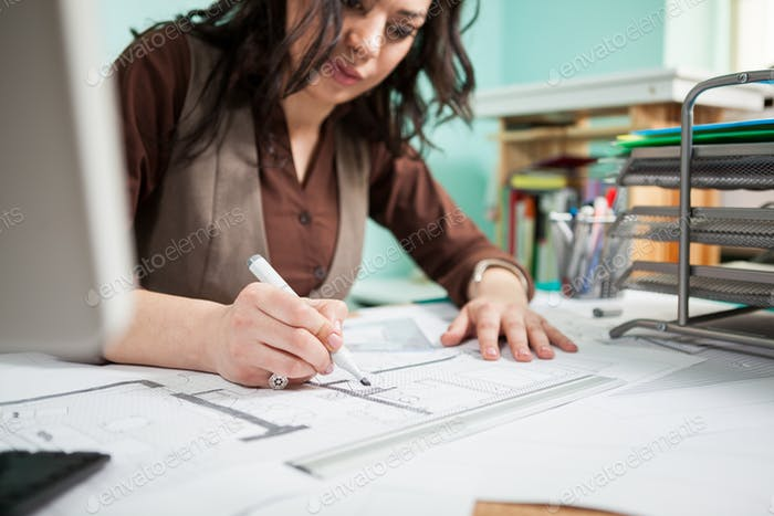Architect at her working desk