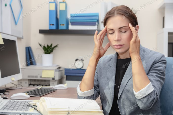 Tired woman at work