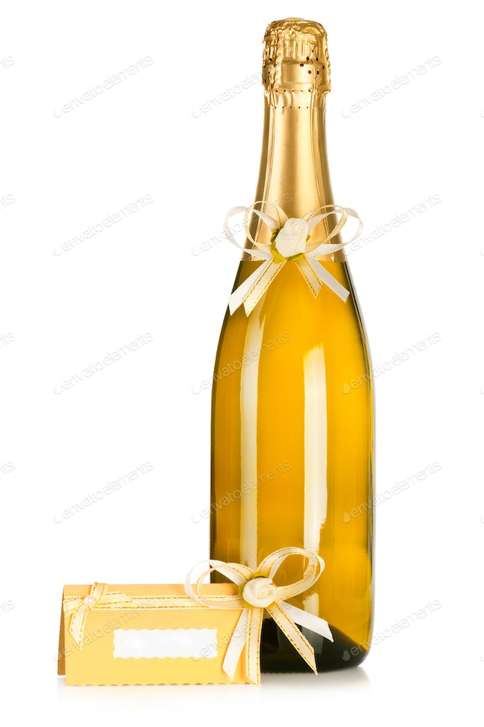 Corked bottle of champagne with wedding decoration