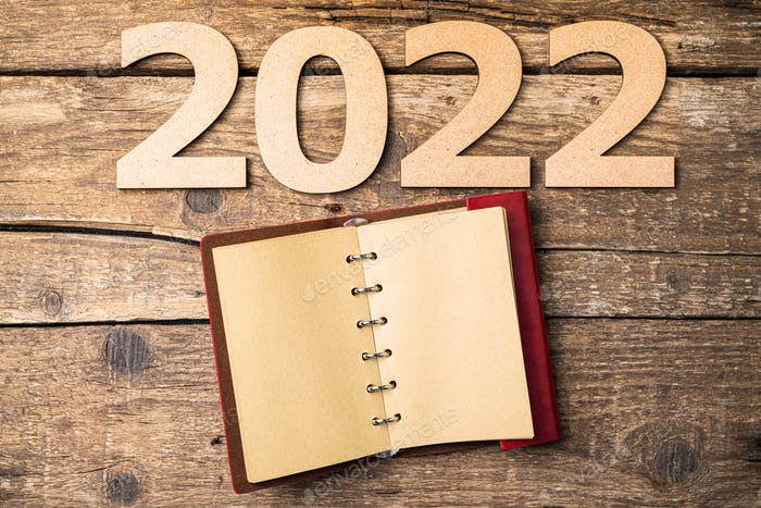 New year resolutions 2022 on desk. 2022 resolutions with open notebook