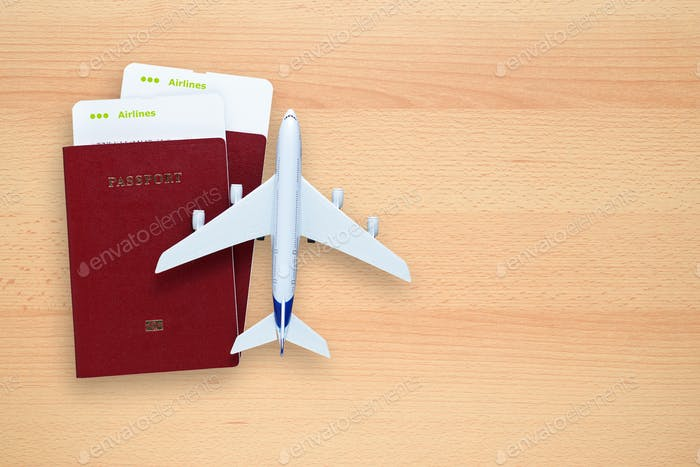 Boarding passes, passports and toy aircraft on desk