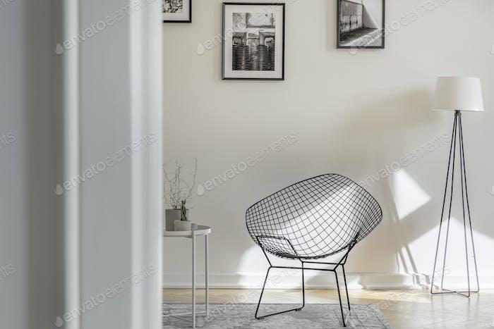 Fancy black metal chair in bright room in tenement house