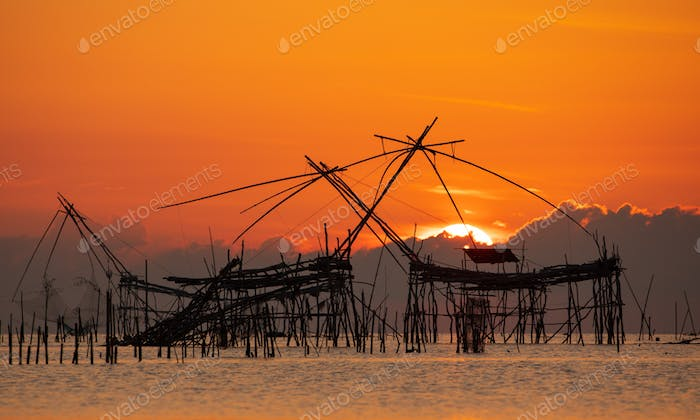 Sunrise with traditional fishing trap in Pak Pra village, Phatthalung, Thailand