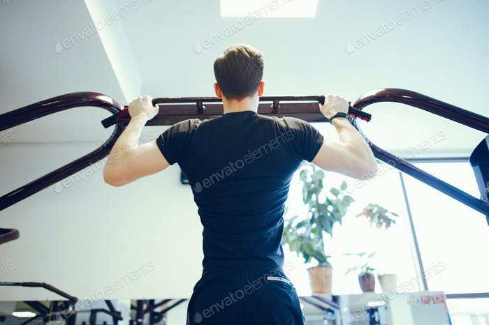 Sports man in a morning gym