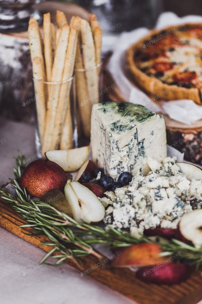 Delicious cheese plate on wedding reception