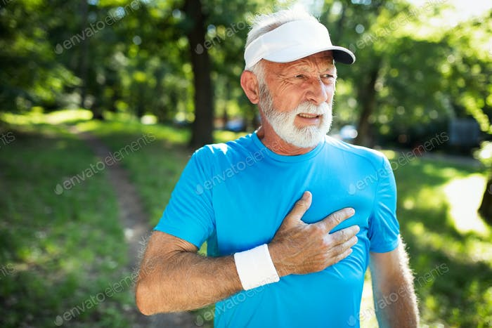 Mature man exercising outdoors to prevent cardiovascular diseases and heart attack