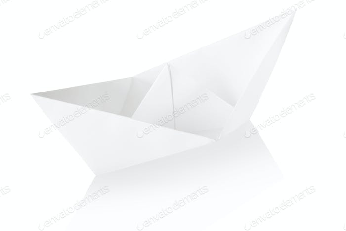 Paper boat on white