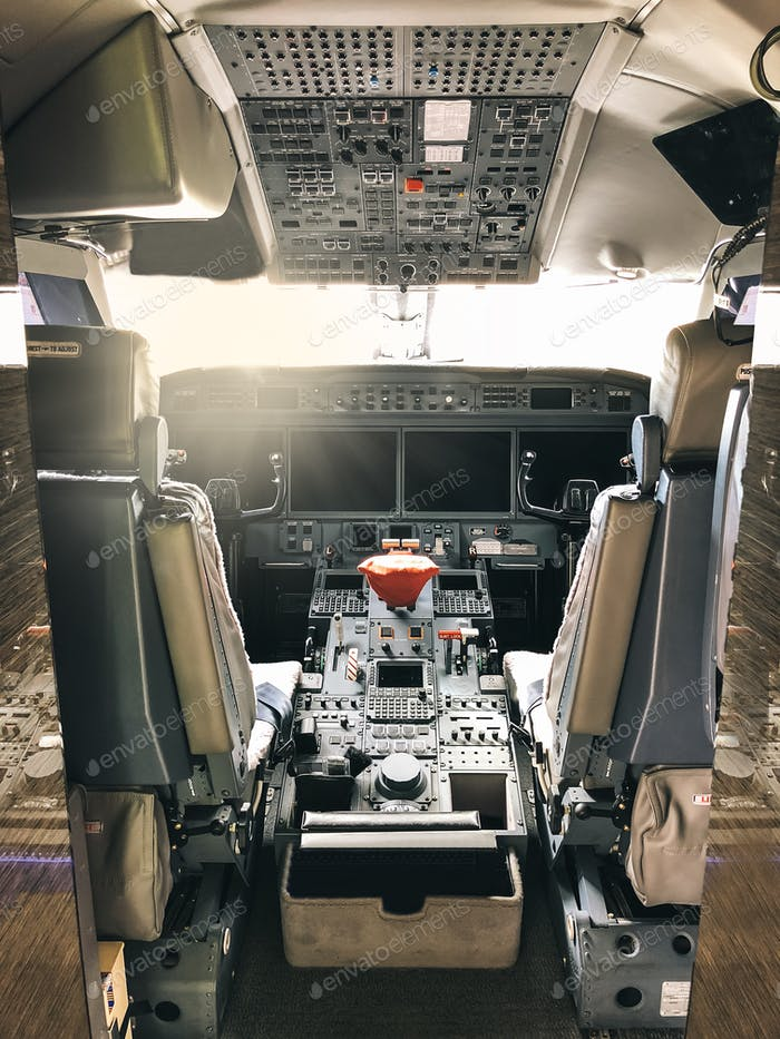 Interior of a pilot cockpit cabin private jet