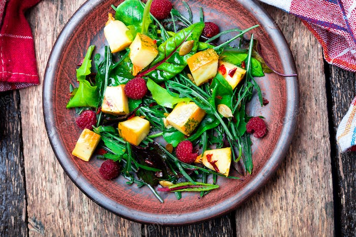 Warm pumpkin salad with raspberries