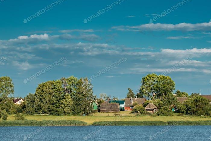 Belarusian Wooden House In Village Or Countryside Of Belarus Wit