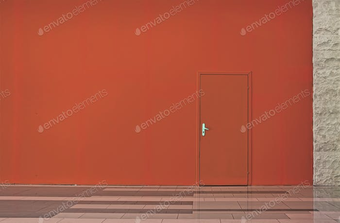 Living Coral color wall with a door.