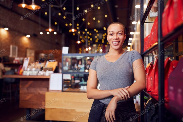 Portrait Of Female Coffee Shop Owner Standing By Counter