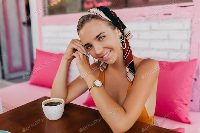Beautiful woman, stylish apparel, wearing shawl and orange t-shirt, fashion trend, summer style