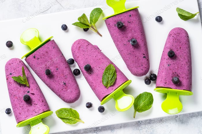 Blueberry ice cream popsicles hamemade top view